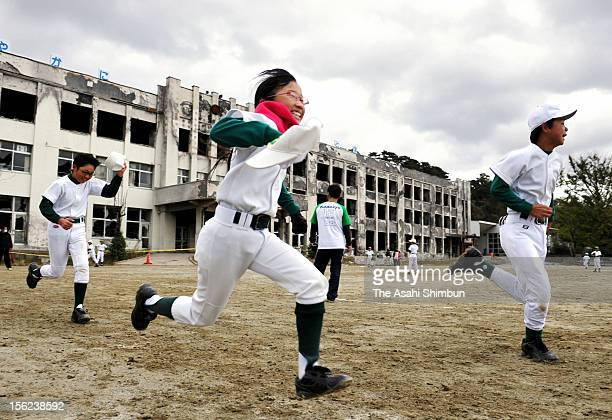 Members of a baseball club attend a training session at Kadonowaki Elementary School on November 11 2012 in Ishinomaki Miyagi Japapn The school...