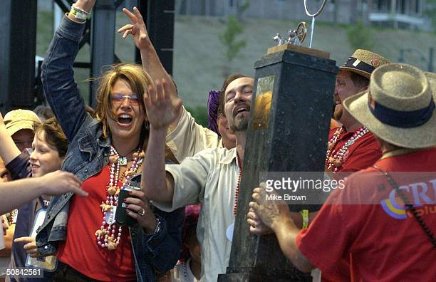Members of a BBQ cooking team react to winning second place in the whole hog division of the 2004 World Championship BBQ Cooking Contest on May 15...