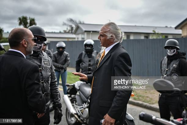 Members of a biker gang are welcomed by Omar Nabi and a mourner of the entourage accompanying the hearse vehicle before the funeral of Omar Nabi's...