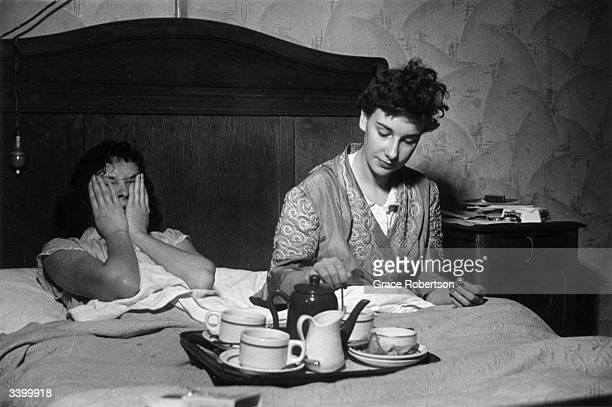 Members of a Bluebell Girls dance troupe Eleanor Madden and Tony relaxing in bed at the Hotel Riboute in Paris November 1951 The troupe is en route...
