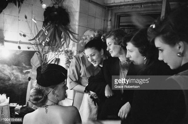 Members of a Bluebell Girls dance troupe visit another Bluebell troupe in the dressing rooms of the Lido club in the ChampsElysees during a stopover...