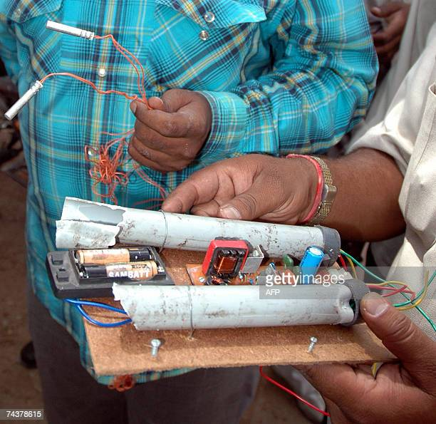 Members of a bomb disposal squad show a detonator which was found in the Alpha Lodge Hotel in Secunderabad 02 June 2007 Detonators were found in a...