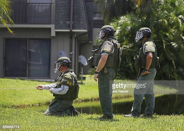 Members of a Bomb Disposal Unit checks for explosives around the apartment building where shooting suspect Omar Mateen is believed to have lived on...