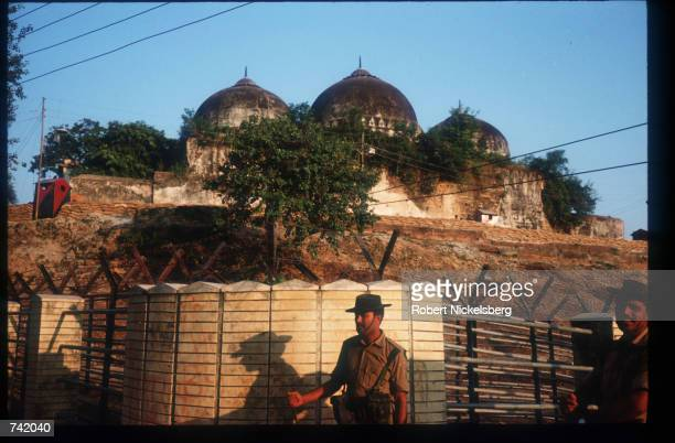 Members of a border security force guard a mosque from attack by militant Hindus October 29 1990 in Ayodhya India While religious parallels and...