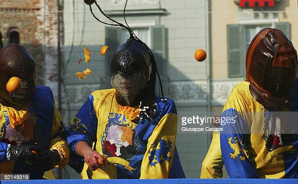 Members of a cart team is seen during the Orange Battle at the 2005 Ivrea Carnival on February 6 2005 in Ivrea Italy During the Orange Battle 3600...