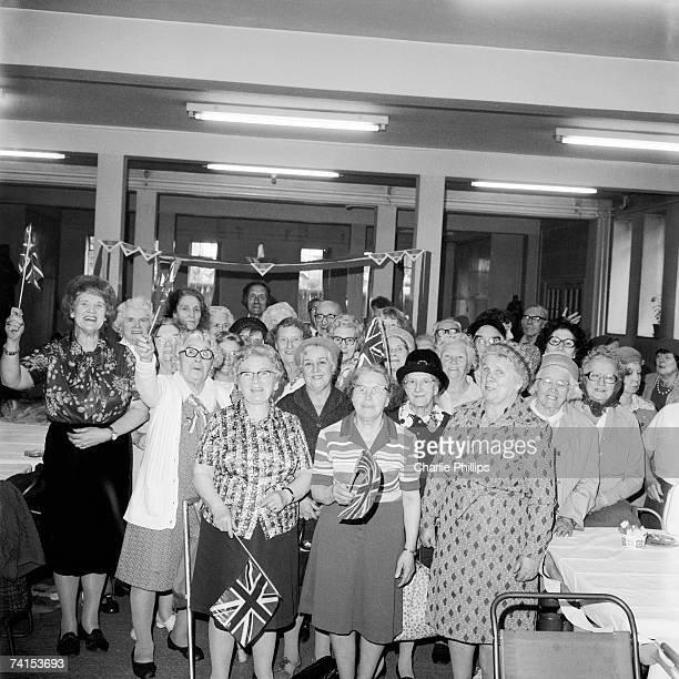 Members of a catholic luncheon club for the elderly celebrate Queen Elizabeth's Silver Jubilee, 1977.