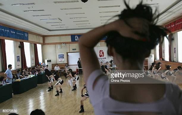Members of a cheering squad dance during training training on July 25, 2008 in Yanjiao of Hebei Province, China. A total of 27 cheering squads which...