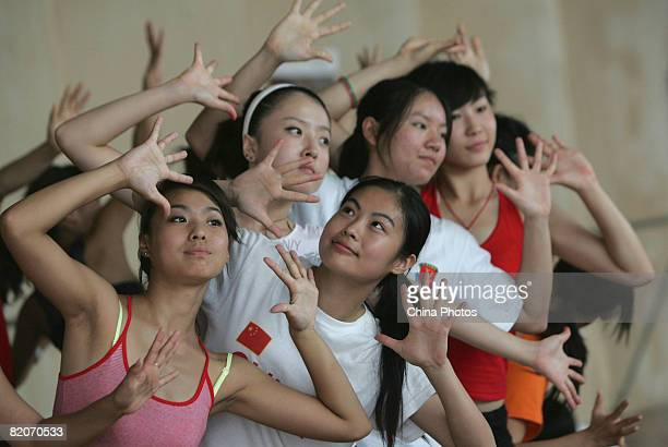 Members of a cheering squad pose during training training on July 25, 2008 in Yanjiao of Hebei Province, China. A total of 27 cheering squads which...