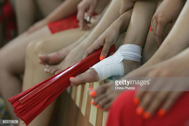 Members of a cheering squad prepare for a training on July 25, 2008 in Yanjiao of Hebei Province, China. A total of 27 cheering squads which will...