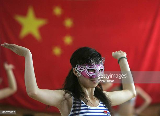 Members of a cheering squad take part in a training on July 25, 2008 in Yanjiao of Hebei Province, China. A total of 27 cheering squads which will...