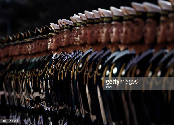 Members of a Chinese military honor guard stand at attention during a welcoming ceremony for US Secretary of Defense Robert Gates at the Bayi...