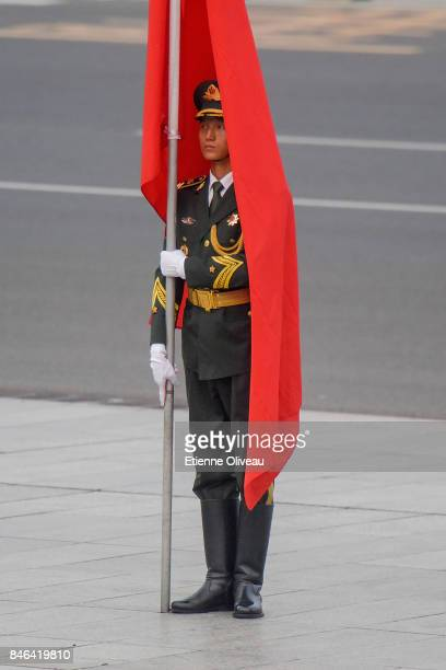 Members of a Chinese military honour guard is wraped within a red flag before a welcome ceremony for Sultan of Brunei Hassanal Bolkiah outside The...