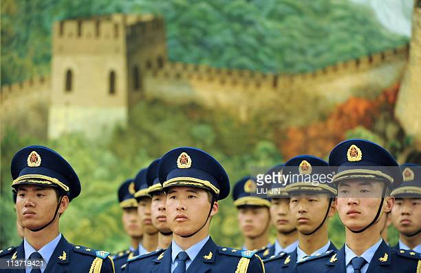 Members of a Chinese military honour guard line up upon the welcoming ceremony for Austrian Chancellor Werner Faymann at the Great Hall of the People...