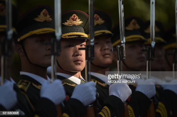 TOPSHOT Members of a Chinese military honour guard prepare before a welcome ceremony for Afghanistan's Chief Executive Officer Abdullah Abdullah in...