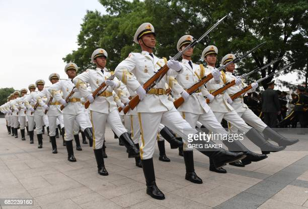 TOPSHOT Members of a Chinese military honour guard rehearse for a welcome ceremony for Uzbekistan President Shavkat Mirziyoyev outside the Great Hall...