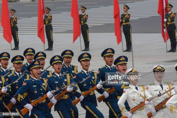 Members of a Chinese military honour guard shout during a welcome ceremony for Sultan of Brunei Hassanal Bolkiah outside The Great Hall Of The People...