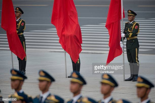 Members of a Chinese military honour guard stand guard before a welcome ceremony for Sultan of Brunei Hassanal Bolkiah outside the Great Hall of the...