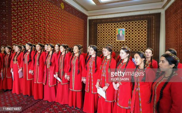 Members of a choir attend a ceremony at the National Carpet Museum in Ashgabat on December 16, 2019. - Turkmenistan's leader on December 17 hailed as...