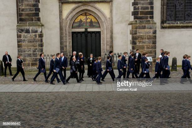 Members of a choir pass by Bishop of the Evangelical Church in Central Germany Ilse Junkermann and Chair of the Council of the Evangelical Church in...