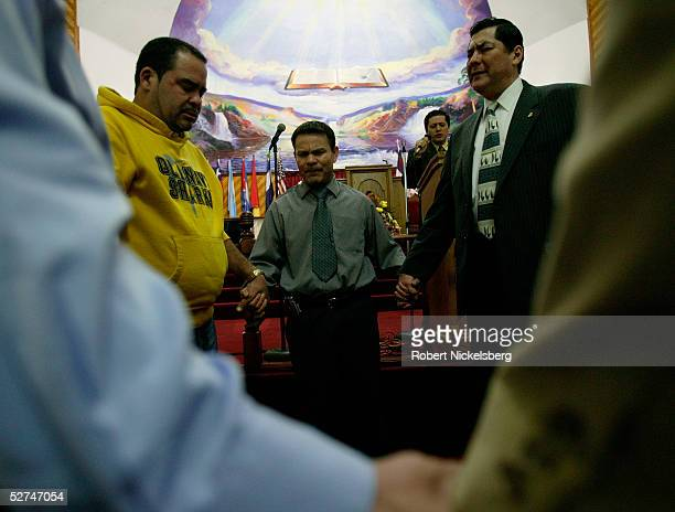 Members of a Christian Pentecostal church pray during an evening service on April 7 2005 in Brooklyn New York city Pentecostal churches throughout...