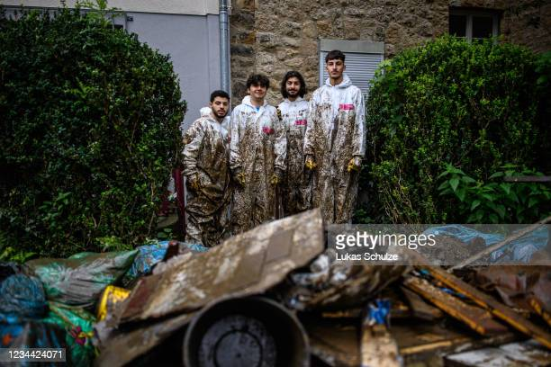 Members of a cleaning company tidy up the basement of a house affected by flash floods on August 3, 2021 in Stolberg, Germany. Stolberg is one of...