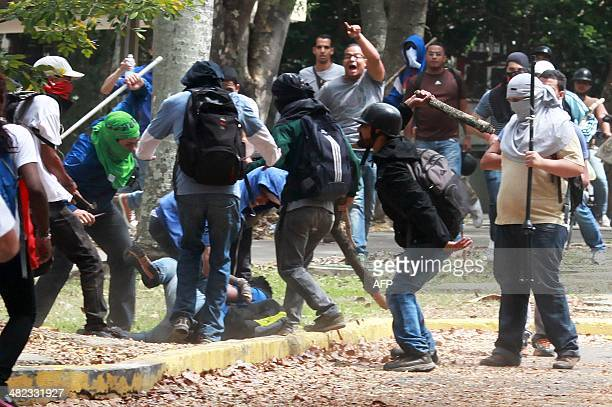 Members of a colectivo pro government group beat an opposition student who was taking part in a protest against the government of Venezuelan...