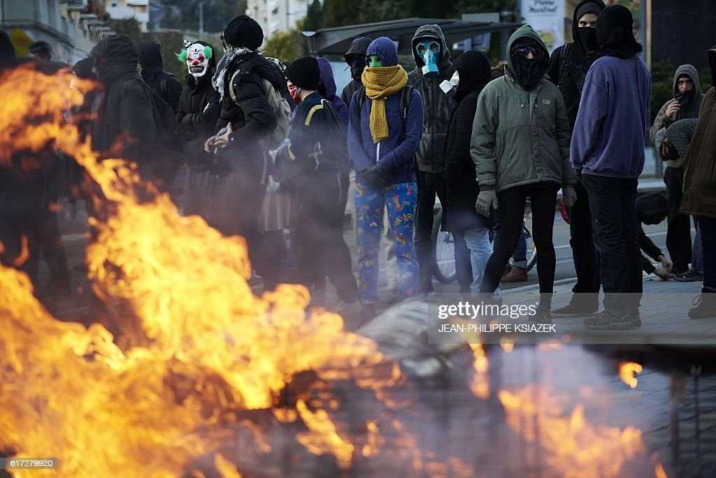 Members of a collective for 'the disarmament of police and the demilitarisation of conflicts' demonstrate on October 22, 2016 in Saint-Etienne. Around 300 people took part in the demonstration today despite a ban from the prefecture. / AFP / JEAN