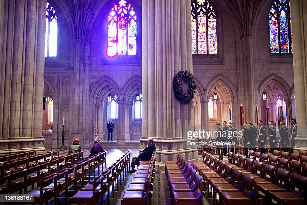 Members of a color guard and others wait for a wreath laying at the National Cathedral December 28 2011 in Washington DC A wreath was placed at the...
