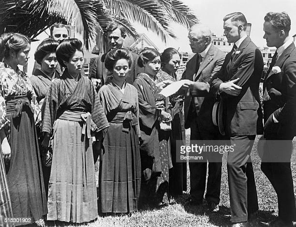 Members of a Congressional committee look over passports of Japanese picture brides at the immigration station of Angel Island