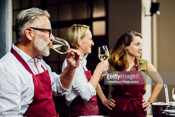 Members of a cooking class drinking some wine