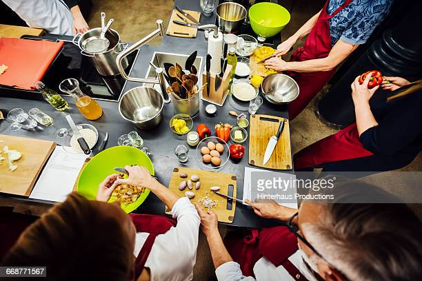 Members of a cooking class preparing food