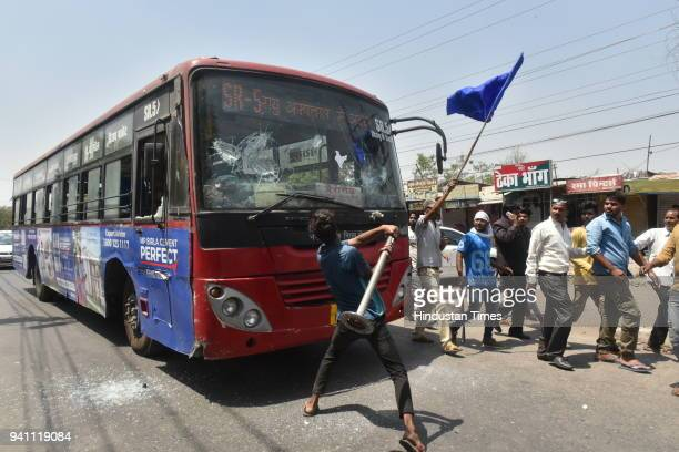 Members of a dalit organisation damaging a BRTS bus during Bharat Bandh called by dalit organisations on April 2 2018 in Bhopal India Nine people...