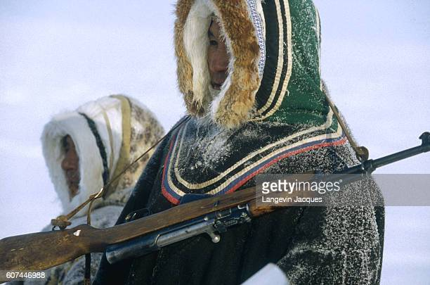 Members of a Dolgan hunting party return to their camp near the village of Syndassko Russia The Dolgans traditionally a nomadic people who live along...