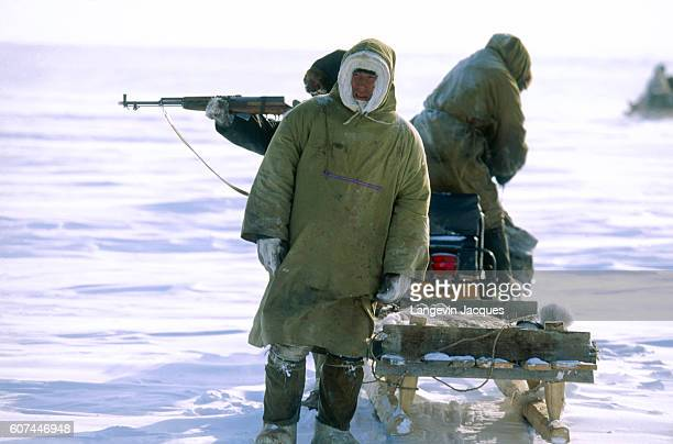 Members of a Dolgan hunting party search for reindeer near the village of Syndassko Russia The Dolgans traditionally a nomadic people who live along...