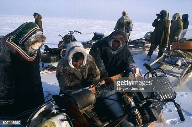 Members of a Dolgan hunting party stop to repair their motorized sled The Dolgans traditionally a nomadic people who live along the Taymyr Peninsula...