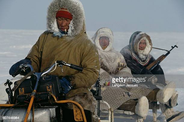 Members of a Dolgan hunting party travel by means of a motorized sled The Dolgans traditionally a nomadic people who live along the Taymyr Peninsula...