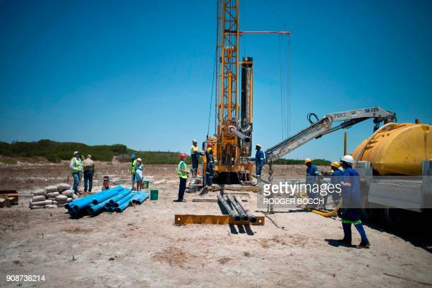 Members of a drilling team prepare to drill at a site where the Cape Town city council has ordered drilling into the aquifer to tap water in...