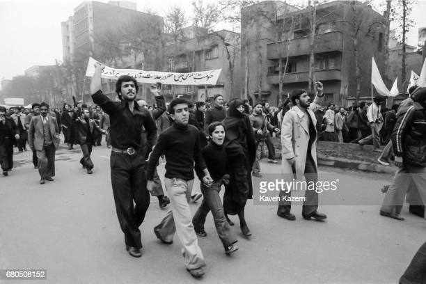 Members of a family holding hands walk amongst demonstrators on Ashura Day in Tehran during the Iranian Revolution 11th December 1978 As many as 17...