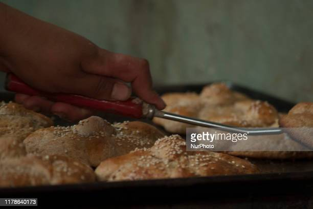 Members of a family in the municipality of Santa Ana Chiautempan are dedicated to the production of the bread of the dead a tradition that is...