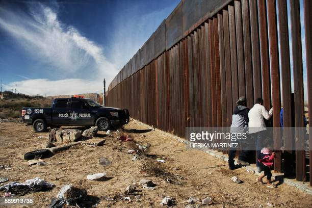 Members of a family meet through the border wall between Mexico and the United States during the 'Keep our dream alive' event in Ciudad Juarez...