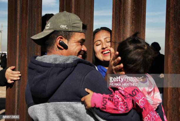 TOPSHOT Members of a family reunite through the border wall between Mexico and United States during the Keep our dream alive event in Ciudad Juarez...