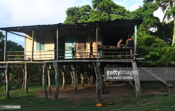 Members of a family stay at home in Prumnitara Puerto Lempira Honduras on July 8 2019 Thousands of fishing divers of the Mosquitia region where...