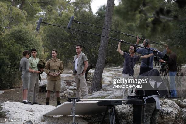 Members of a film crew shoot a scene on the set of an Israeli television series outside the Beit Jamal monastery near the central city of Bet Shemesh...