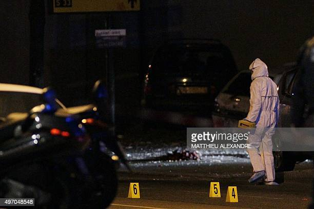 Members of a forensics team work behind a police cordon at the scene of an attack near the Stade de France in Saint Denis suburban Paris on November...