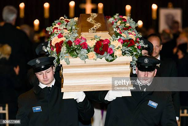 Members of a funeral parlour carry the coffin of the deceased TV Producer Wolfgang Rademann after his memorial service on February 11 2016 in Berlin...