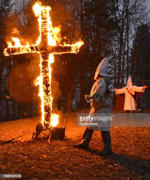 Members of a group called the Honorable Sacred Knights of the Ku Klux Klan burn a cross in the suburbs of Madison Indiana on Jan 26 2019 ==Kyodo