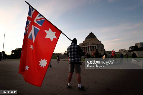 Members of a group calling themselves the United Kingdom of Australia hold a dawn service at the Shrine of Remembrance in protest to lockdown...