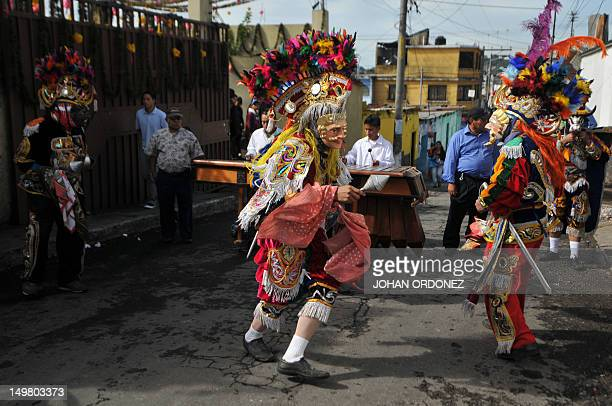 Members of a Guatemalan folk group perform the traditional 'El Torito' dance on August 4 2012 during the Santo Domingo de Guzman festival in the...