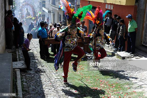 Members of a Guatemalan folk group perform the traditional 'El Torito' dance on August 28 2012 during the celebration of San Agustin in Sumpango...