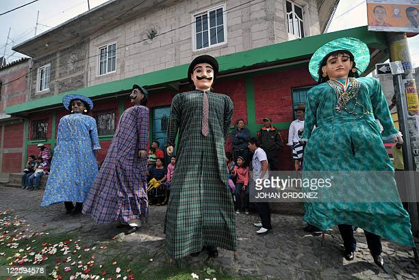 Members of a Guatemalan folk group perform the traditional 'Los Gigantes' dance on August 28 2011 during the celebration of San Agustin in Sumpango...